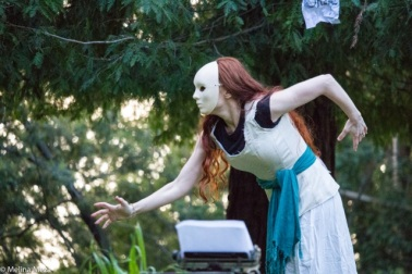Christy Crowley in a solo dance in Joaquin Miller Park. Photo by Melina Meza.