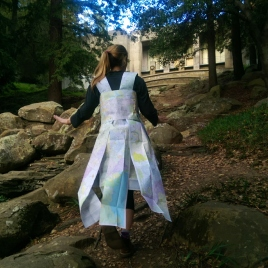 Julie Katz journeys up the Joaquin Miller Park Cascades in a map dress created by Rebecca Longworth.